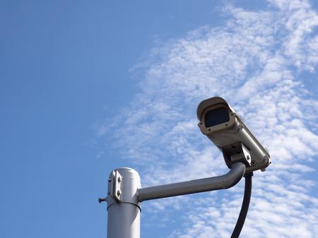 Surveillance Security Camera or CCTV on blue sky background with copy space Reklamní fotografie