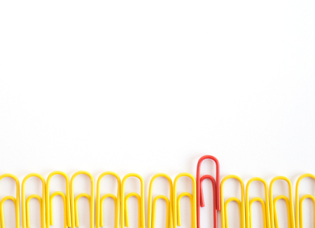 Paper clips arrange to symbolize to be different or  leadership like boss (able to imply to various meaning)