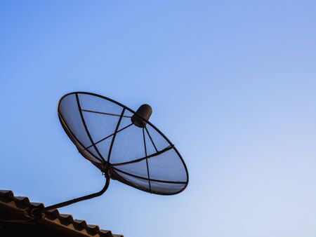 satelite: Satelite dish for digital television signal on the roof ot the house with blue sky for copy space