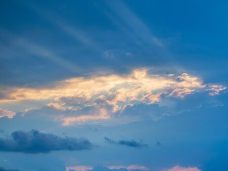 Beautiful cloud at sunset with light over the blue sky