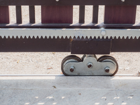 close up of steel wheel of automatic slide house gate