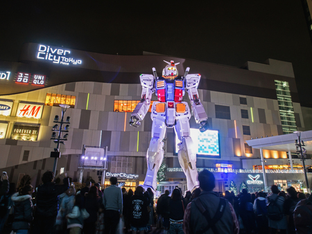 ODAIBA, TOKYO, JAPAN - MARCH 30, 18-meter Mobile Suit Gundam RX78 robot in front of DiverCity Tokyo Plaza, Odaiba at night. Gundam is a well-known Japanese robot animation.