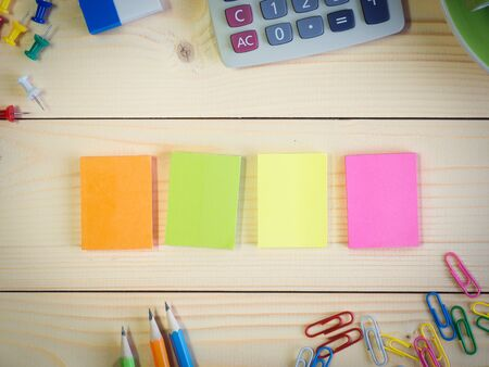 Colorful sticky notepad and stationery on the wooden table with copy space Archivio Fotografico