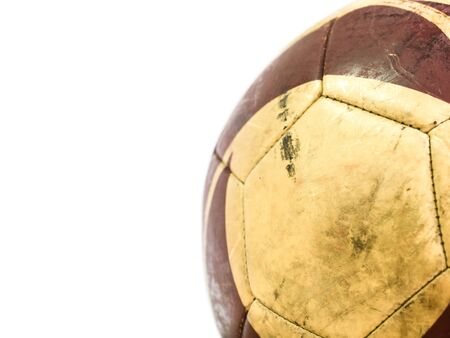 Close up part of old muddy dirty football isolated on white background with copy space (selective focus)