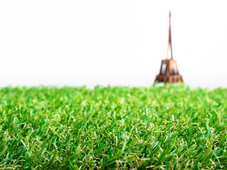 Artificial grass with blurry background of Eiffel tower