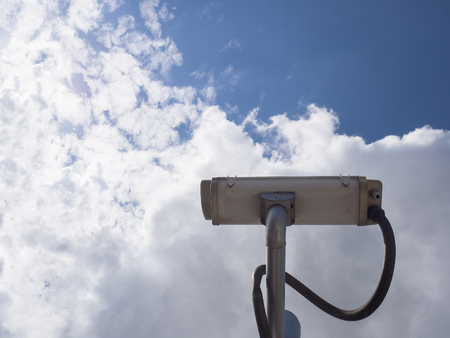 Surveillance Security Camera or CCTV on blue sky background with copy space Archivio Fotografico