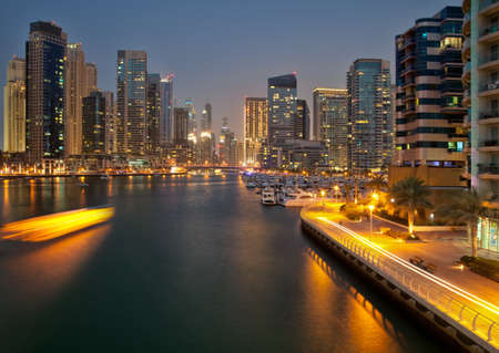 Skyscrapers of Dubai captured in the dusk  Dubai is an artificial canal city, carved along a two mile stretch of Persian Gulf shoreline  photo