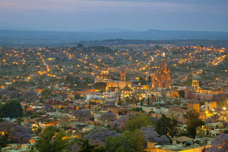 Illuminated skyline of San Miguel de Allende in Mexico after sunset  photo