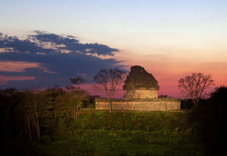 Ruins of Observatory building in Chichen Itza of Mexico at the Sunset  photo
