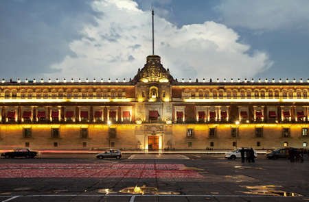mexico city: Illuminated National Palace in Plaza de la Constitucion of Mexico City at sunset  Zocalo and Army Square are among other local names of this place  Editorial