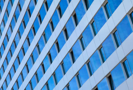 converging: Exterior of a contemporary skyscraper with Converging panes of glass windows  Stock Photo