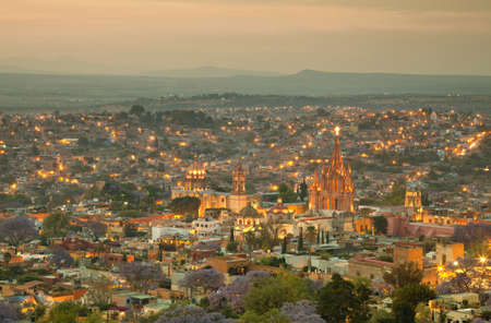 Illuminated skyline of San Miguel de Allende in Mexico after sunset