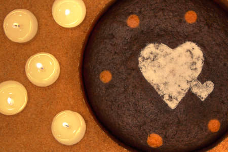 chocolate cake, cooked and decorated with candles to be served as valentine day's special dessert   photo