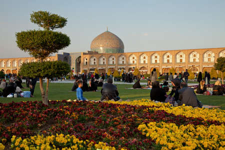 picnicking: People Picnicking in the Naqsh-e Jahan Square of Isfahan, Iran  This square has been constructed between 1598 and 1629, which is now one of UNESCO Editorial