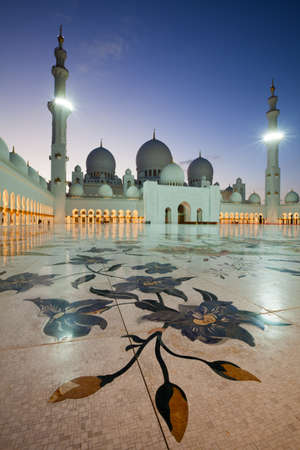 Illuminated Sheikh Zayed grand mosque of Abu Dhabi in the dusk  photo