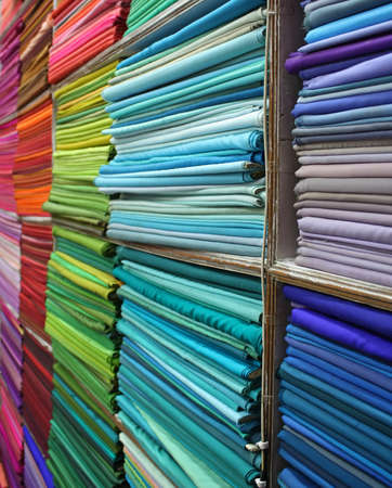 indian fabric: Shelves full of colorful textiles in an Indian fabric store
