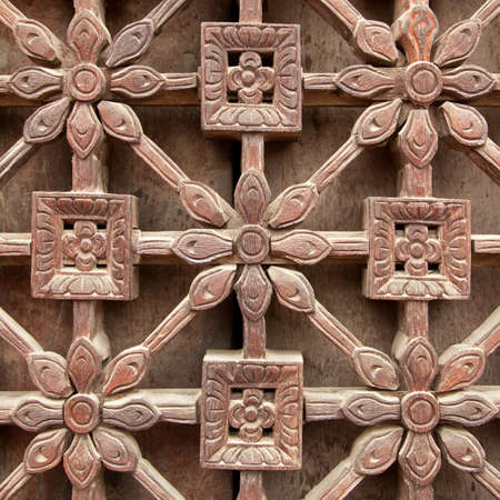 latticework: Carved wooden latticework with pattern of flowers and squares   Stock Photo