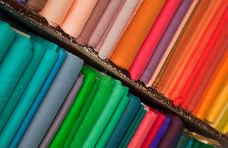 Shelves of colorful textiles and fabrics photo