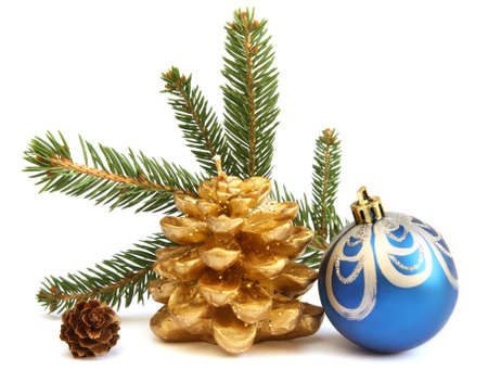 Isolated golden pine cone and blue Christmas ball photo
