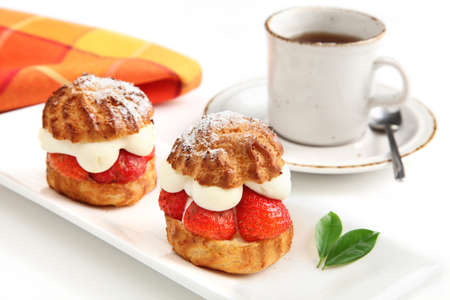 Strawberry cakes and cup of coffee photo