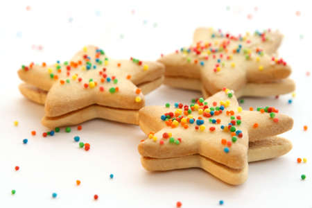 comfit: Star shaped cookies decorated with colorful toppings