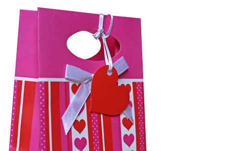 Pink paper pocket decorated with red hearts photo