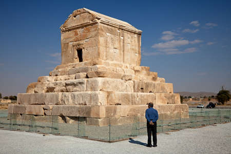 cyrus: A Man Standing Beside Cyrus Tomb in Pasargad of Iran.