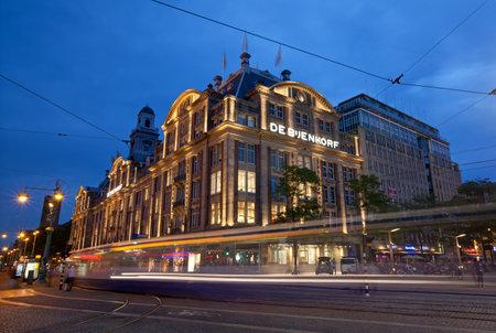 dam square: Illuminated De Bijenkorf store on Dam Square of Amsterdam, Netherlands.