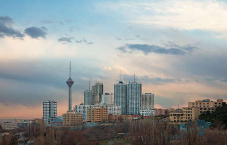 among: Skyline of Tehran with Milad Tower among high rise buildings.