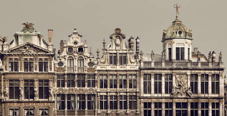 guildhalls: Vintage brown filter on historical buildings located in Grand Place of Brussels, Belgium. Stock Photo