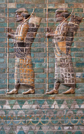 frieze: Colorful glazed brick frieze of Persian Achaemenid warriors from Susa of Iran. Stock Photo