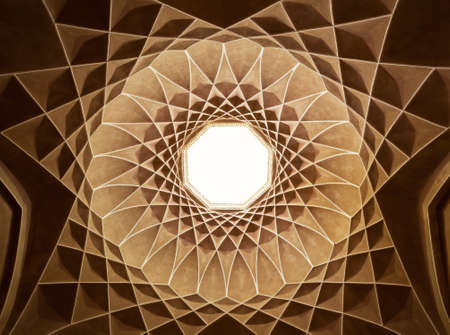 plasterwork: Old brown plasterwork with geometric Persian design of Governor Pavilion at Dolat Abad Garden of Yazd. Stock Photo