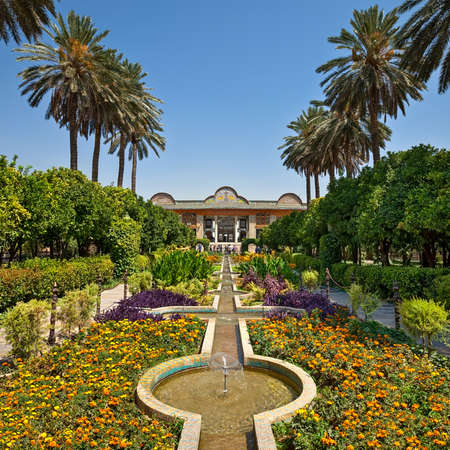 Beautiful Persian garden of Narenjestan Ghavam or Qavam with its historic pavilion and engineered system of canals and fountains.