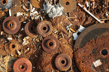 Used hand grinder metal grinding discs at trash dump