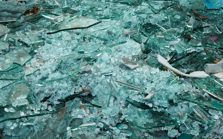 illegal dumping of shattered glass/broken piece in a junkyard Banco de Imagens