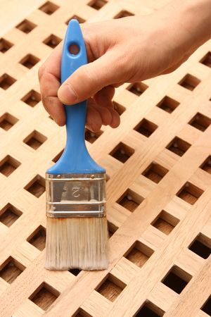 Hand painting wooden furniture piece Stock Photo