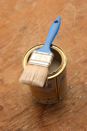 Blue brush on an opened can of varnish Stock Photo