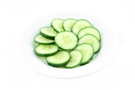 Fresh cucumber slices on the white plate Stock Photo