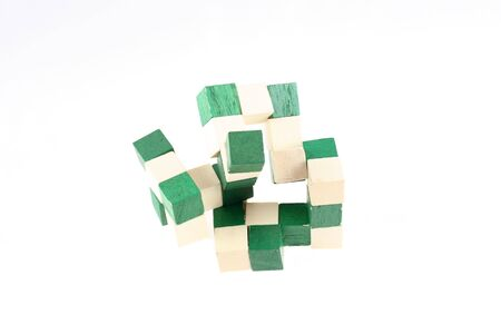 brainteaser: Wooden brainteaser on white background Stock Photo