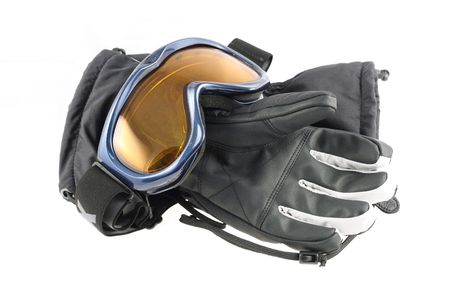protecting spectacles: Ski goggles and winter gloves on white background