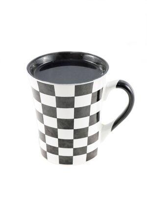 Checked mug of tea on white background