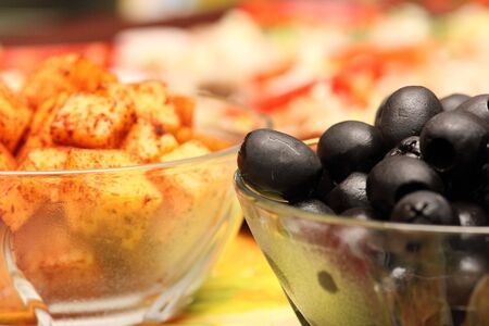 Close up of two small bowls with black olives and cheese Stock Photo