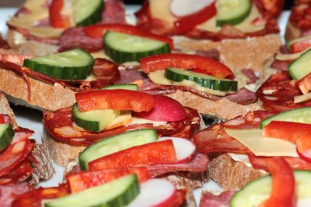 Tasty sandwiches with salami and vegetables