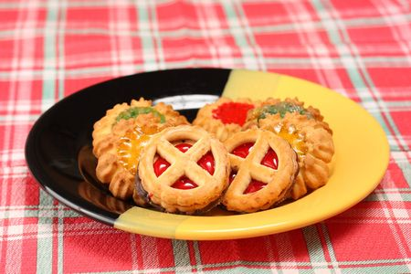Various kinds of biscuits on decorative dish