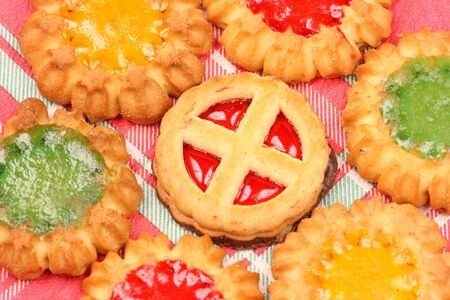 Various kinds of biscuits on decorative tablecloth