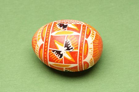 Hand painted easter egg on green background