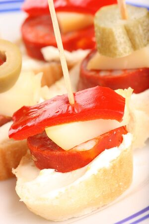 Detail of fresh snack with pepper, cheese and sausage Stock Photo