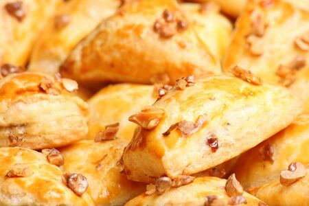Crisp puff cakes with pieces of walnuts Stock Photo