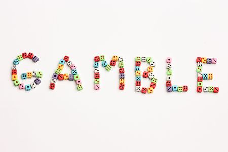 Word Gamble made of colorful dices Stock Photo