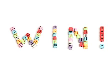 The word Win made of colorful dices photo